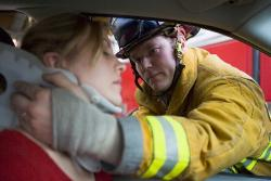 firefighter saving woman from car